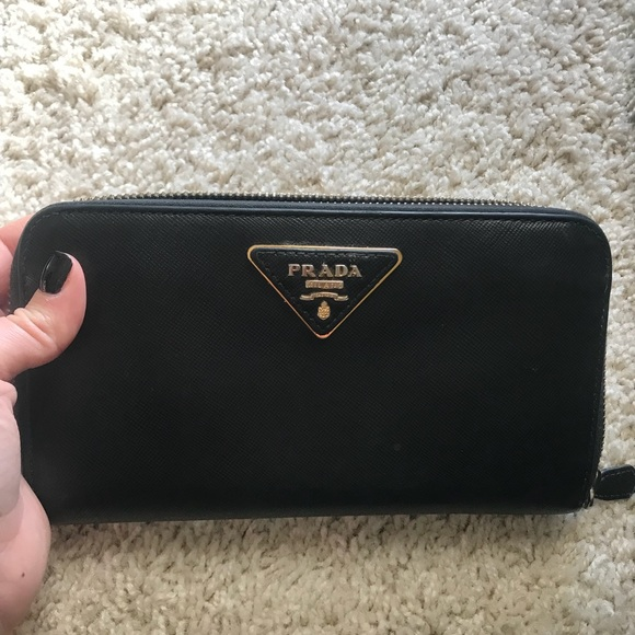 094d544b675d81 Authentic Prada Zip Around Saffiano Leather Wallet.  M_5aa5cbdb5521bec4a104b28e